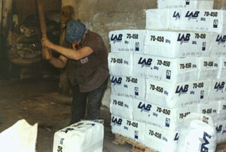 """Safe Use"" of Canadian asbestos in Brazil – breaking open the bags. F. Giannasi photo."