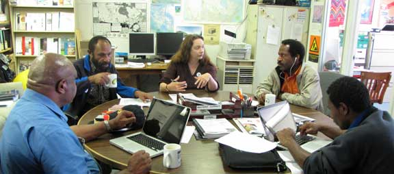 Porgera delegation visits the MiningWatch office, from left to right: Anga Atalu, Jethro Tulin, Catherince Coumans, Mark Ekepa, and Jeffery Simon. Susan Murdock photo.