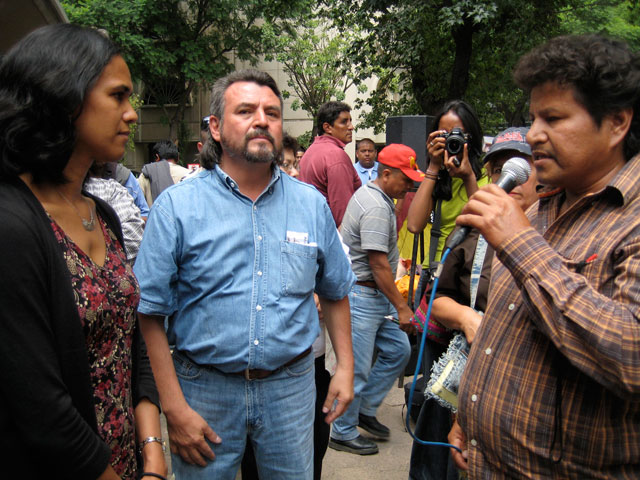 Mariano Abarca at a protest in front of the Canadian Embassy in July, 2009 (Mariano holding microphone and speaking with an Embassy Public Relations representative)