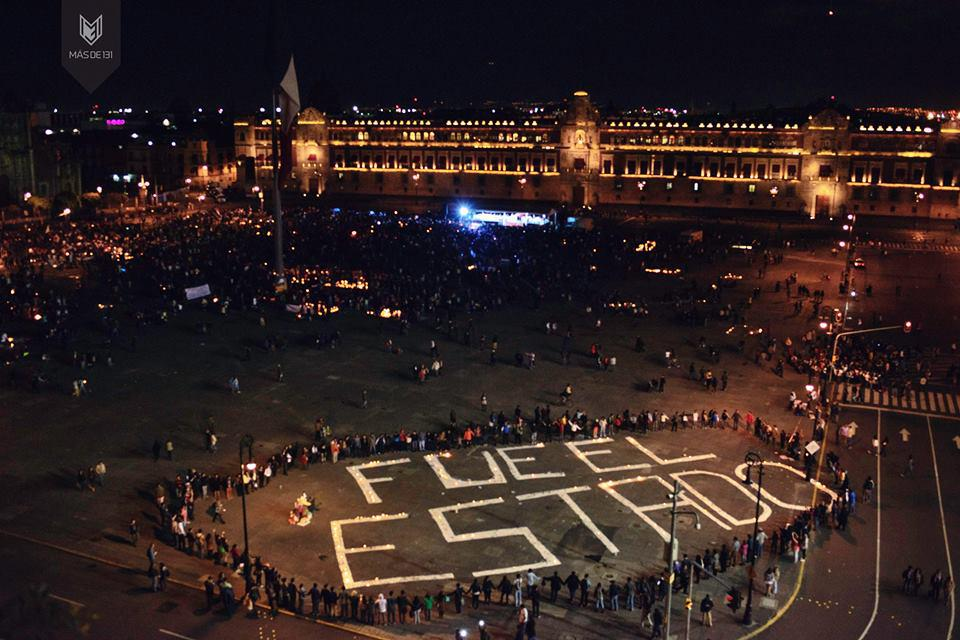 """Photo of demonstration in the central plaza of Mexico City. The message reads: """"It was the state"""""""